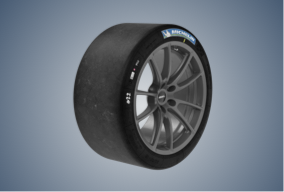 "Michelin Pilot Sport GT tire with 19""wheel standing up, surrounded by gray-blue vignette"