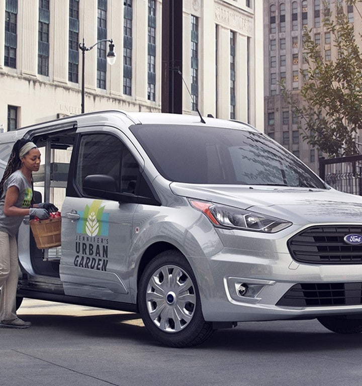 The transit connect cargo van picks up flowers at a farmers market