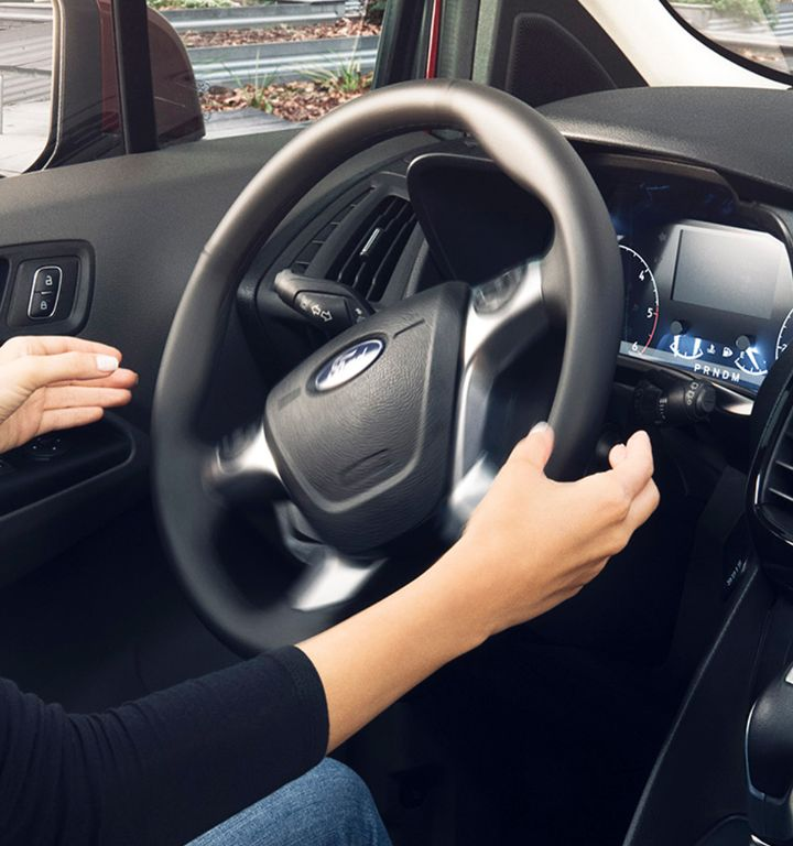 A driver using the available active park assist feature
