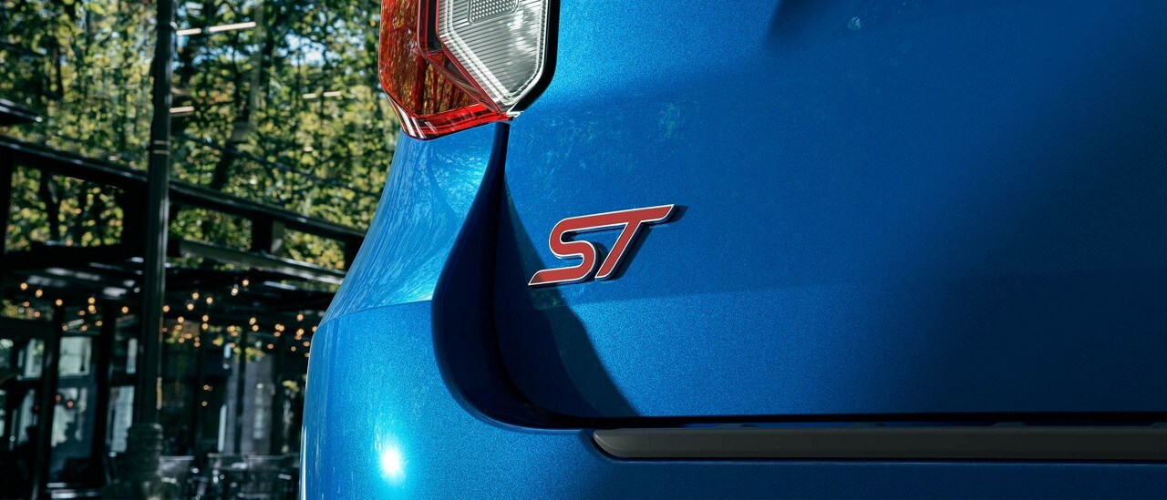 Closeup shot of the badging of an Explorer ST in Atlas Blue